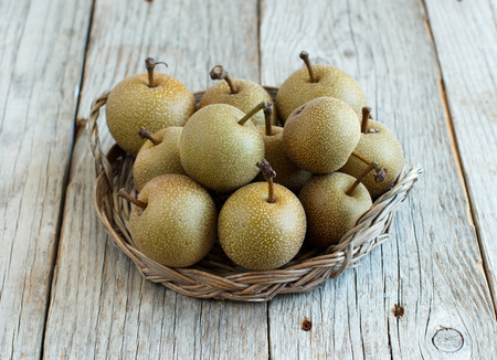 Nashi Pears (apple pears or asian pears) on a wooden table