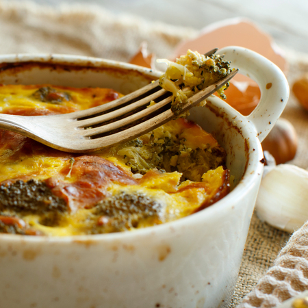 Casserole with broccoli on a rustic background closeup Archivio Fotografico