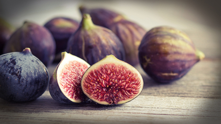 Fresh fruits - figs on the wooden table retro styled