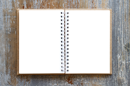 Blank opened notebook on a wooden table top view Archivio Fotografico