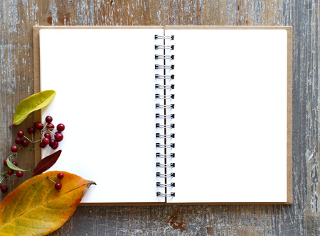 Autumn background with leaves and open notebook top view