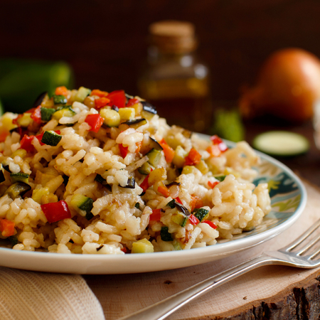 Risotto with vegetables on a wooden table close up Reklamní fotografie