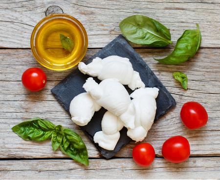 Italian cheese mozzarella nodini with tomatoes and  herbs  Archivio Fotografico