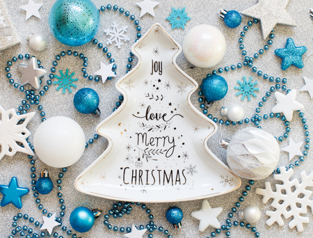 Turquoise blue and silver festive christmas decorations with plate
