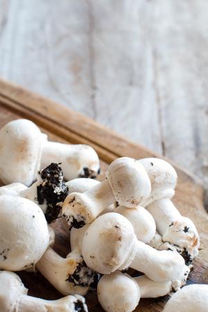 Champignon Mushrooms on an old wooden table Archivio Fotografico