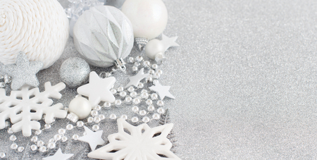 Silver Christmas decorations on a silver table close up Archivio Fotografico