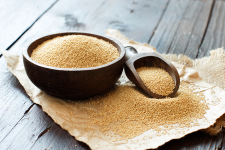 Raw Organic Amaranth grain in a bowl on wooden table Stok Fotoğraf