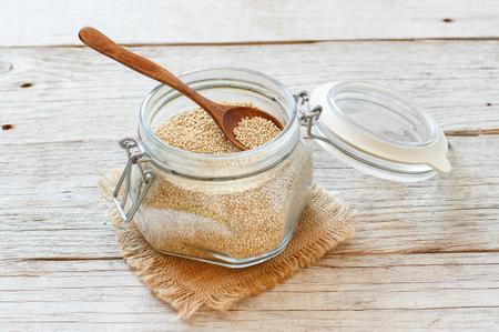 Uncooked  quinoa grain in a glass close up Archivio Fotografico