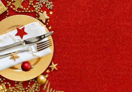Red and golden festive table setting top view