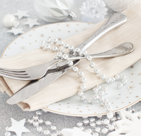 Silver Christmas Table Setting with christmas decorations  Archivio Fotografico