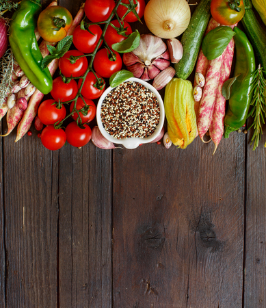 Uncooked mixed quinoa with vegetables on wood Archivio Fotografico