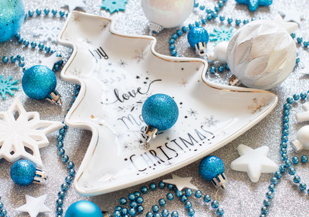 Silver and turquoise Christmas decorations close up