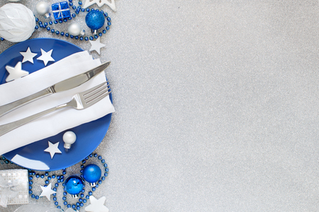 Silver and blue Christmas Table Setting with christmas decorations