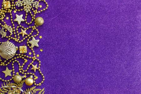 Purple and golden festive christmas decorations top view Archivio Fotografico