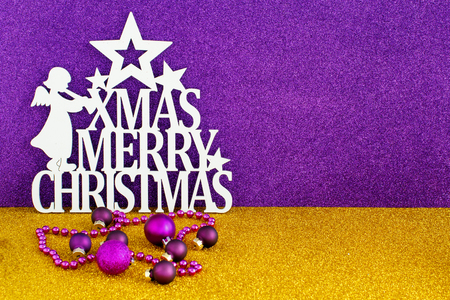 Christmas sign with Golden and purple background and decorations