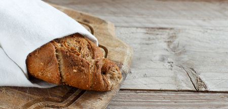 Wholemeal Bread on a Wooden Table top view Archivio Fotografico