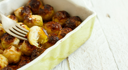 Roasted Brussel Sprouts in a small casserole from the oven