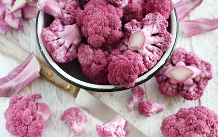 Fresh raw purple cauliflower in a bowl close up