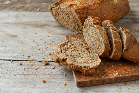 Wholemeal Bread on a Wooden Table close up Archivio Fotografico