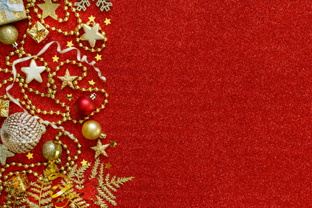 Golden and red Christmas decorations top view Archivio Fotografico