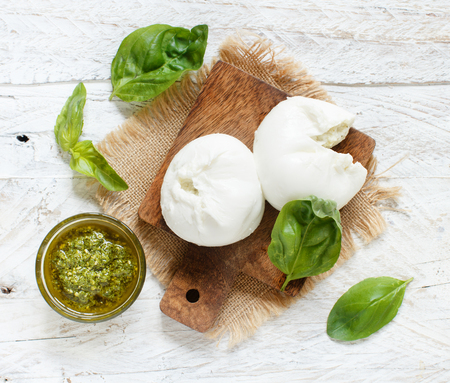 Italian mozzarella cheese stuffed with ricotta and persto close up
