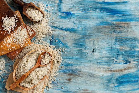 Celtic  Grey Sea Salt with a spoon on a blue wooden table Archivio Fotografico