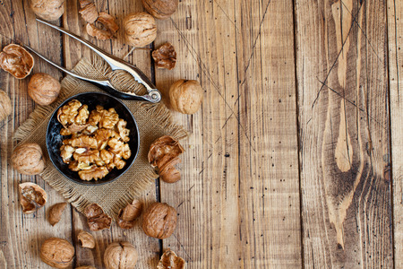 Fresh walnuts on a wooden table close up