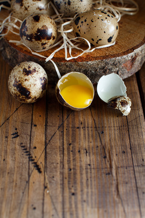 Quail eggs on a wooden background close up