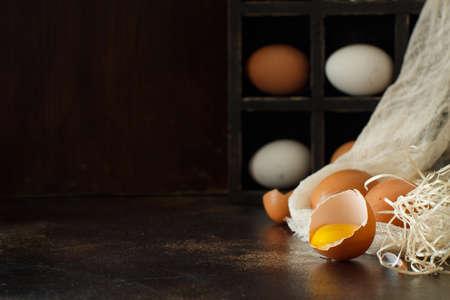Ð¡hicken eggs  on a dark background close up