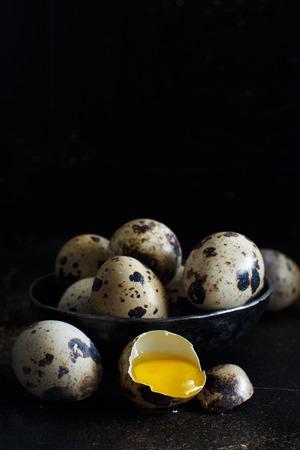 Quail eggs  on a dark background close up