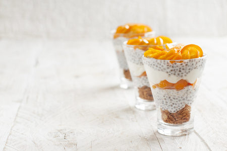 Chia pudding parfait, layered with kumquat  and granola