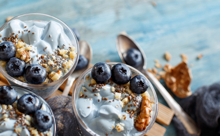 Blueberries and yogurt chia pudding parfait in a glass close up