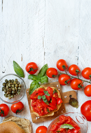 Frisella, typical south italian bread seasond with tomatoes and herbs