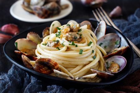 Linguini with clams - Traditional italian seafood pasta 写真素材