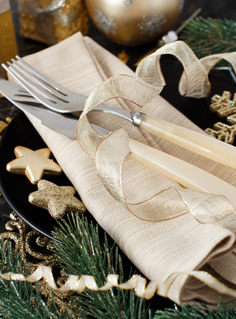 Golden and black Christmas Table Setting  with christmas decorations