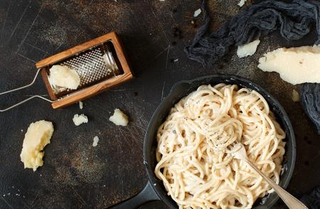 Cacio e pepe, italian cheese and pepper pasta top view