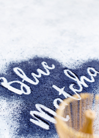 Butterfly pea powder word with wrisk Reklamní fotografie