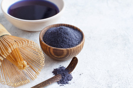 Butterfly pea blue matcha powder and mixed with water