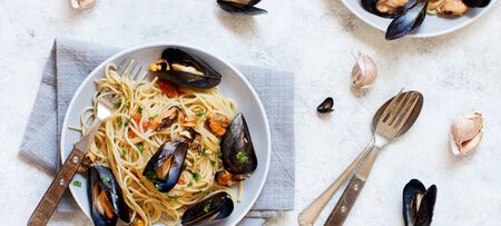 Spaghetti with mussels and tomatoes italian seafood pasta top view Stok Fotoğraf
