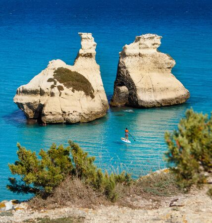 The Two Sisters stacks in front of the shore of Torre dell'Orso. Province of Lecce, Salento, Apulia, Italy.