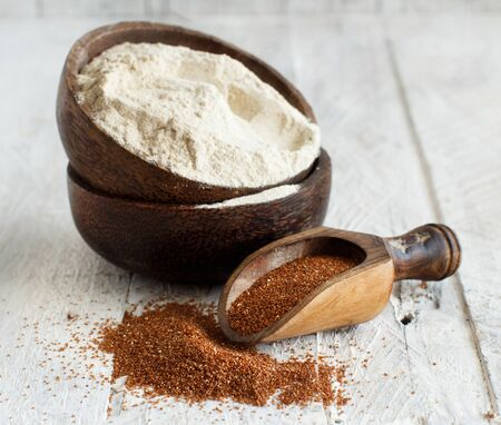 Teff flour in a bowl and teff grain with a spoon close up