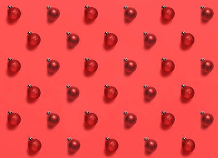 Red Christmas baubles on a red background pattern