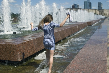 beauty fountain: The girl in a fountain in Moscow Stock Photo