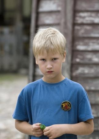 Sad boy of outdoor photo