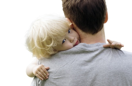 Closeup portrait of young toddler baby  resting on daddy's shoulder