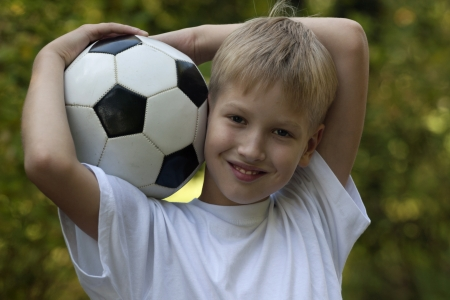 The boy with a football photo