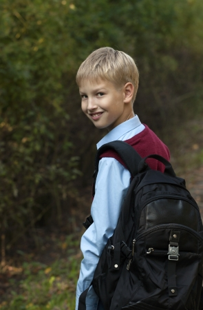 School boy with backpack  photo