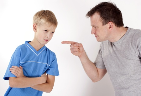 authority: Strict father punishes his son. Isolated on white background