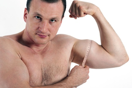 nipple man: Man measuring his bicep muscle. Isolated on white background  Stock Photo