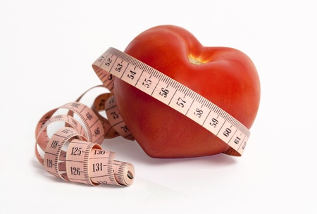 Weight and heart. Vegetables and measuring tape for a healthy lifestyle